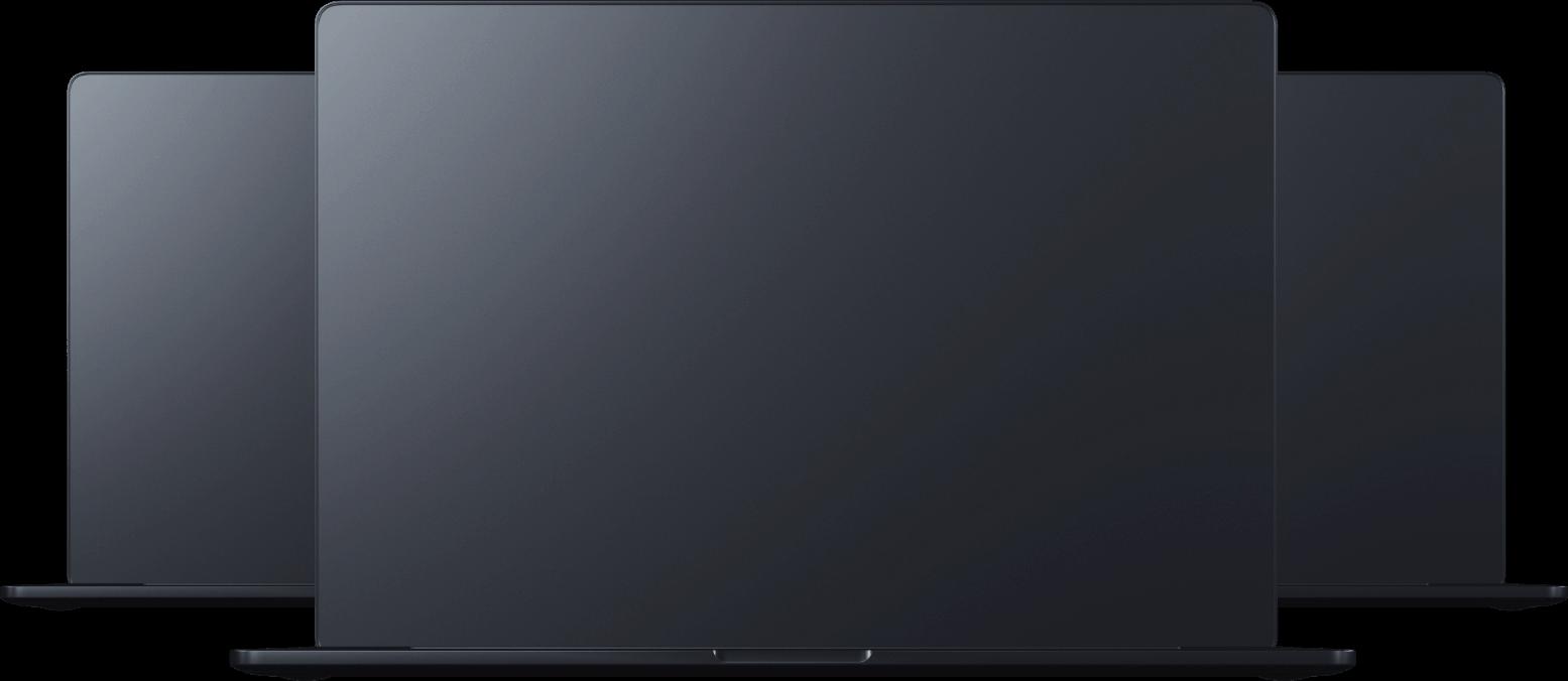 Tři tmavě černé otevřené notebooky